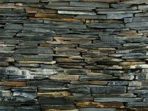 Abstrakt bakgrund av den färgrika stenväggen Arkivbilder