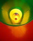 abstrakt bakgrund av den plast- tunnelen i många färgar Arkivbild