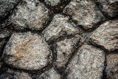 Abstrakt bakgrund av den spruckna stenen Arkivbild