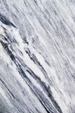 Abstrakt bakgrund av en bearbetad marmorsten Arkivfoto