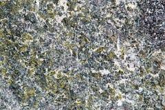 Abstrakt bakgrund av en bearbetad marmorsten Arkivfoton