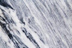 Abstrakt bakgrund av en bearbetad marmorsten Fotografering för Bildbyråer