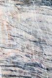 Abstrakt bakgrund av en bearbetad marmorsten Royaltyfria Foton
