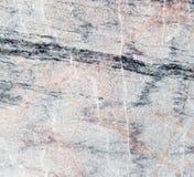 Abstrakt bakgrund av en bearbetad marmorsten Arkivbilder