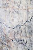 Abstrakt bakgrund av en bearbetad marmorsten Royaltyfri Foto