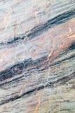 Abstrakt bakgrund av en bearbetad marmorsten Royaltyfri Bild