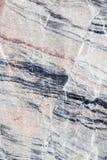 Abstrakt bakgrund av en bearbetad marmorsten Royaltyfri Fotografi