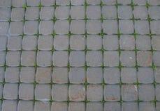 Abstrakt bakgrund av en gammal kullerstenvägcloseup seamless textur Arkivbilder