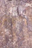 Abstrakt bakgrund av en gammal sprucken cementvägg Arkivfoton