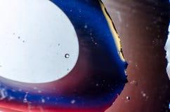 Abstrakt bakgrund av färgrika droppar och droppar av ramen för vatten eller för olja över huvud taget Royaltyfri Bild