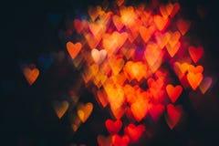 Abstrakt bakgrund av färgrika hjärtor i rörelse Arkivbild