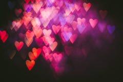 Abstrakt bakgrund av färgrika hjärtor i rörelse Arkivfoton