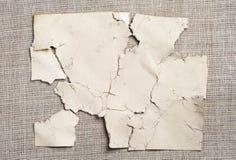 Abstrakt bakgrund av gammalt sönderrivet skyler över brister Fotografering för Bildbyråer