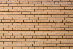 Abstrakt bakgrund av gult murverk. Tegelstenvägg. Royaltyfri Bild