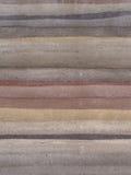Abstrakt bakgrund av i lager sandsten Arkivbild