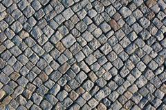 Abstrakt bakgrund av kullerstentrottoar Royaltyfri Fotografi