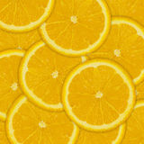 Abstrakt bakgrund av orange fruktskivor Arkivbilder