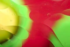 Abstrakt bakgrund av yttersidan med cirklar och krabba linjer av olika format av gult, grönt och rött arkivbilder