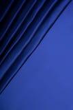 Abstrakt bakgrund, blått tyg för gardin. Royaltyfri Fotografi