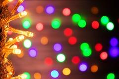 abstrakt bakgrund Det suddiga nya året tänder girlander Arkivbild