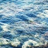 Abstrakt bakgrund för färgstänk för våg för blått vatten Royaltyfria Foton