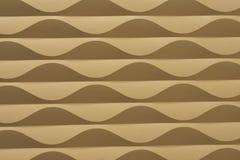Abstrakt bakgrund för guld- vågor Arkivfoton