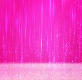 Abstrakt bakgrund för rosa färger med textur och suddiga ljus Arkivfoton