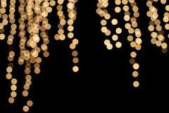Abstrakt bakgrund f?r ljus nattstadsbokeh som bl?nker stj?rnor p? bokeh Orange bokeh i botten av bilden Har ett svart royaltyfria foton