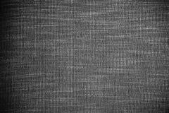 Abstrakt bakgrund från svart tygtextur Bilden f?r tillfogar textmeddelandet Bakgrund f?r designkonstarbete arkivfoton