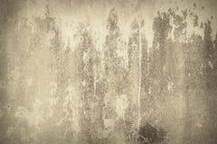 Abstrakt bakgrund, gammal brun målarfärg på väggen royaltyfria bilder