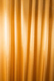 Abstrakt bakgrund, gardin, draperar guld- tyg. Fotografering för Bildbyråer