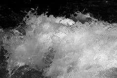 abstrakt bakgrund Grovt vatten med färgstänk Fotografering för Bildbyråer