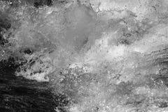 abstrakt bakgrund Grovt vatten med färgstänk Royaltyfri Bild