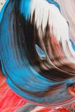 Abstrakt bakgrund i pastellfärgade röda, blåa och svarta signaler Arkivfoto