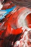 Abstrakt bakgrund i pastellfärgade signaler av rött, blått och svart Royaltyfria Bilder
