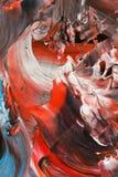 Abstrakt bakgrund i pastellfärgade signaler av rött och svart med blått Arkivbilder
