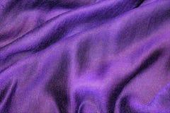 Abstrakt bakgrund i purpurfärgade lila signaler Veck av tisuen Arkivbild