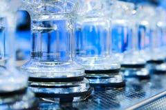 Abstrakt bakgrund med blåa glass rör Royaltyfri Bild