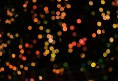 Abstrakt bakgrund med bokehljus och stjärnor Arkivfoto