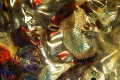 Abstrakt bakgrund med den mjuka modellen i guld arkivfoto