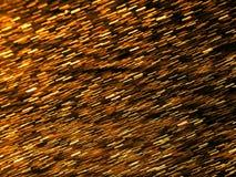 Abstrakt bakgrund med guld- blänker Arkivfoton