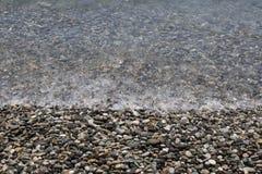 Abstrakt bakgrund med kiselstenar - runda havsstenar Royaltyfri Foto