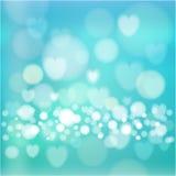 Abstrakt bakgrund med ljus, hjärtor, bokeh