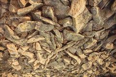 Abstrakt bakgrund med naturliga stenstycken Textur av steniga berg Royaltyfria Bilder
