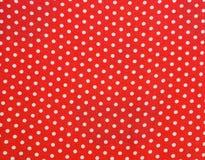 Abstrakt bakgrund med röda och vitprickar Royaltyfria Foton