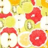 Abstrakt bakgrund med skivor av nya frukter Sömlös modell för en design Fotografering för Bildbyråer