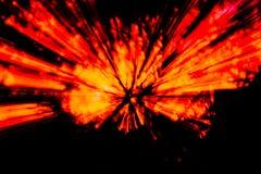 Abstrakt bakgrund som p?minner av en bristningsenergi som ?r m?ngf?rgad, str?lar, royaltyfri bild