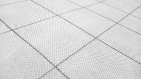 Abstrakt bakgrund texturerade materiell yttersida från stora fyrkanter för en geometrisk modell och tunna delningar som en mall f royaltyfri fotografi