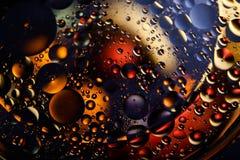 abstrakt bakgrundsavstånd Vattendroppar av olika färger Arkivfoto