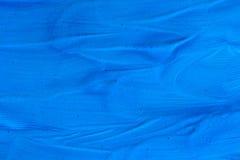 Abstrakt bakgrundsblåttyttersida av torkad målarfärg Arkivfoton